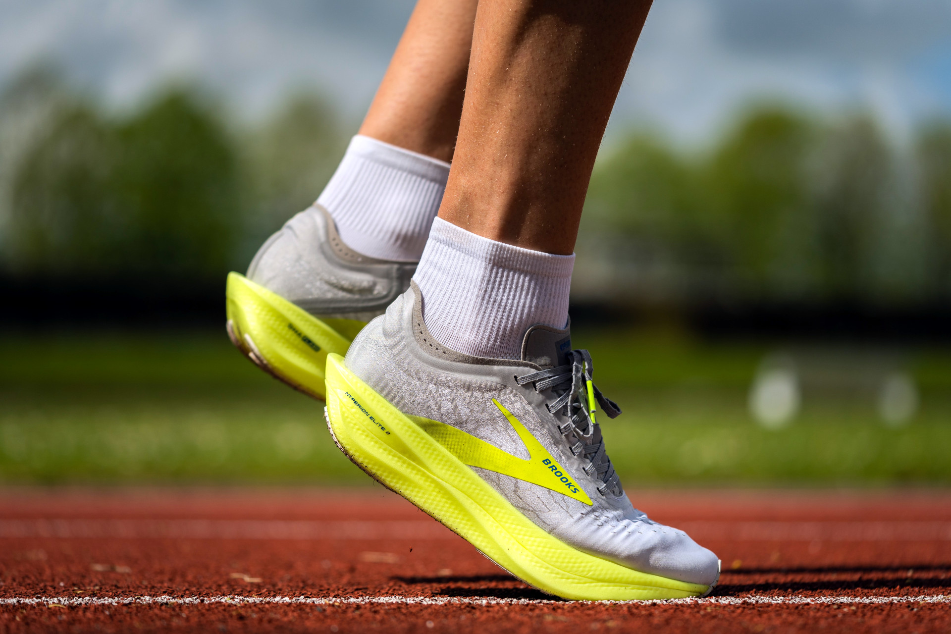 Person wearing running shoes on race track - fun run